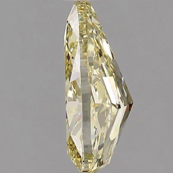 Фото желтого бриллианта огранки груша сбоку