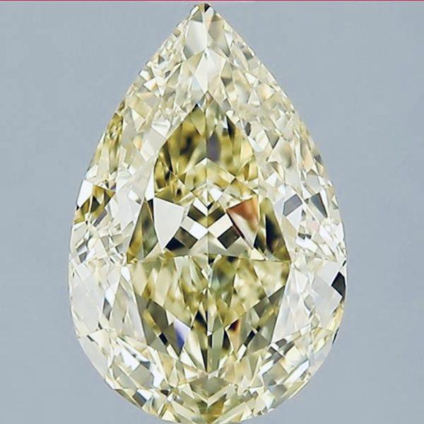 Желтый бриллиант огранки груша фото спереди